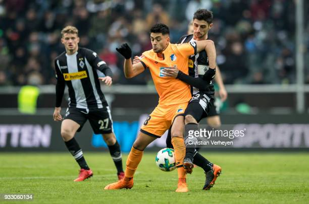 Nadiem Amiri of 1899 Hoffenheim and Lars Stindl of Borussia Moenchengladbach battle for the ball during the Bundesliga match between Borussia...