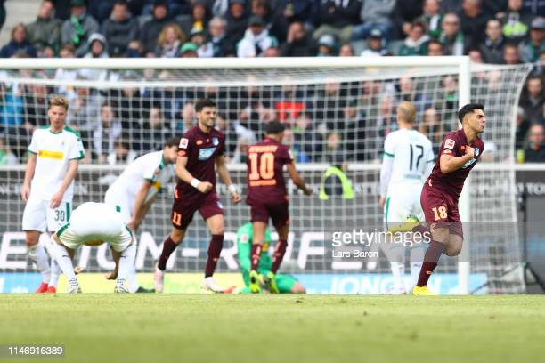 Nadiem Amiri of 1899 Hoffenheim celebrates after scoring his team's second goal during the Bundesliga match between Borussia Moenchengladbach and TSG...