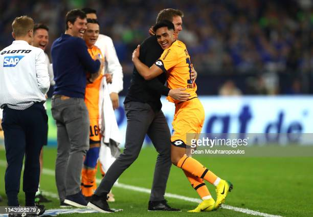 Nadiem Amiri of 1899 Hoffenheim celebrates with Julian Nagelsmann manager of 1899 Hoffenheim after scoring his sides fourth goal during the...