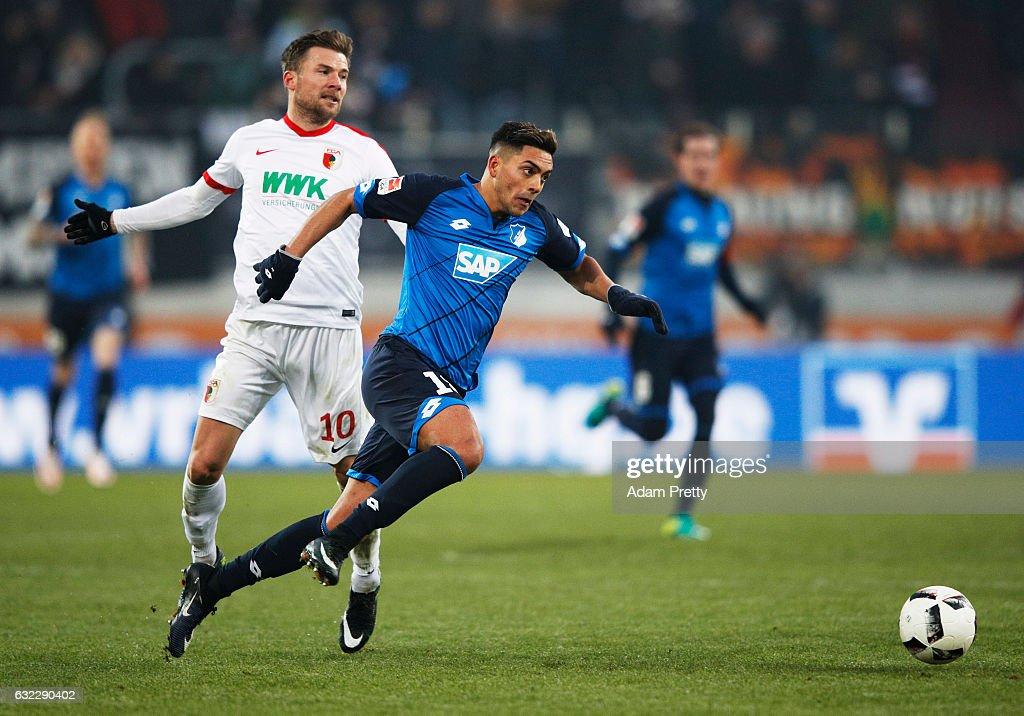Nadiem Amiri of 1899 Hoffenheim is challenged by Daniel Baier of Augsburg during the Bundesliga match between FC Augsburg and TSG 1899 Hoffenheim at WWK Arena on January 21, 2017 in Augsburg, Germany.