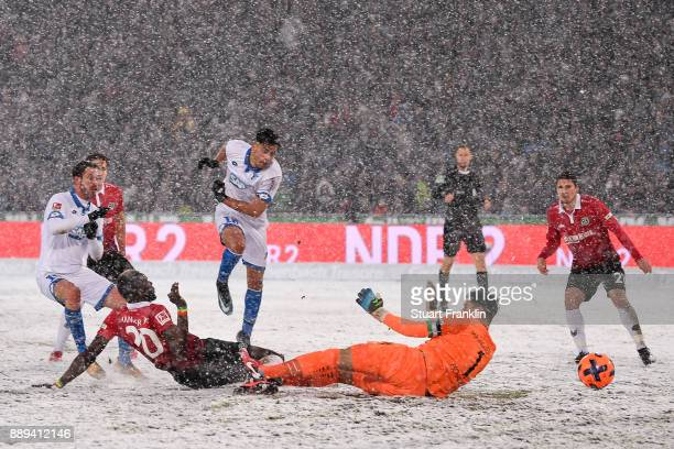 Nadiem Amiri of 1899 Hoffenheim scores a later disallowed goal against goalkeeper Philipp Tschauner of Hannover 96 during the Bundesliga match...
