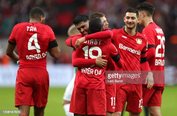 Nadiem Amiri of Bayer 04 Leverkusen celebrates with teammates after scoring his team's second goal during the Bundesliga match between Bayer 04...