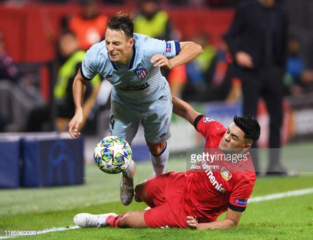 Nadiem Amiri of Bayer 04 Leverkusen fouls Santiago Arias of Atletico Madrid resulting in a red card during the UEFA Champions League group D match...