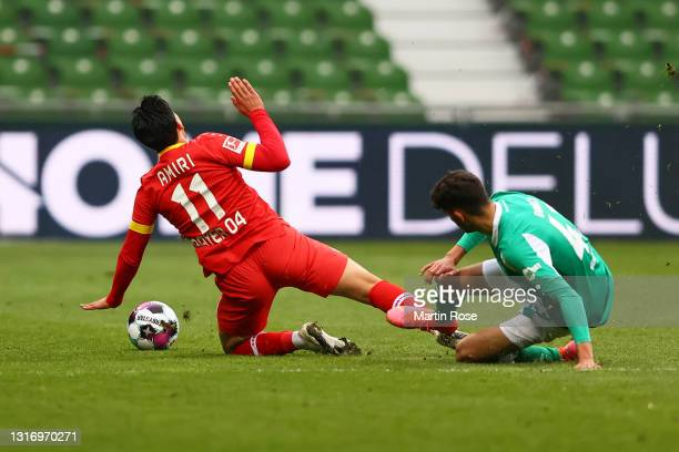 Nadiem Amiri of Bayer 04 Leverkusen is challenged by Eren Dinkci of SV Werder Bremen and is later shown a red card during the Bundesliga match...
