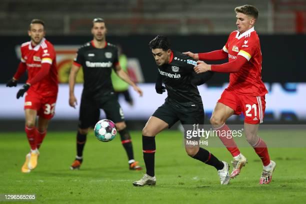 Nadiem Amiri of Bayer 04 Leverkusen is challenged by Grischa Promel of 1. FC Union Berlin during the Bundesliga match between 1. FC Union Berlin and...