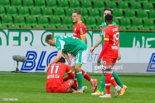 Nadiem Amiri of Bayer 04 Leverkusen, Maximilian Eggestein of SV Werder Bremen, Florian Wirtz of Bayer 04 Leverkusen, Kevin Moehwald of SV Werder...