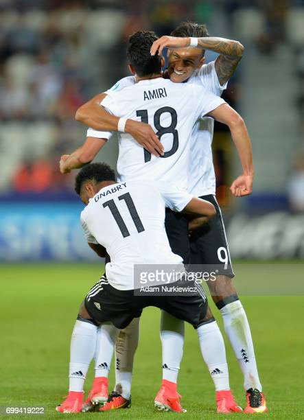 Nadiem Amiri of Germany celebrates scoring his sides third goal with Davie Selke of Germany and Serge Gnabry of Germany during the UEFA European...