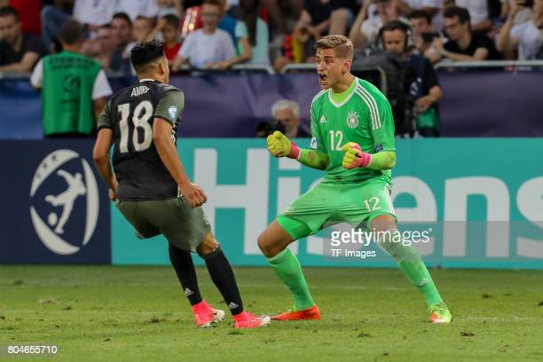 Nadiem Amiri of Germany Goalkeeper Julian Pollersbeck of Germany celebrates after after wining the game during the UEFA European Under21 Championship...