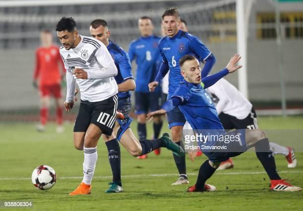 Nadiem Amiri of Germany in action against Ardian Ismajli of Kosovo during the 2019 UEFA Under21 European Championship qualifier match between Kosovo...