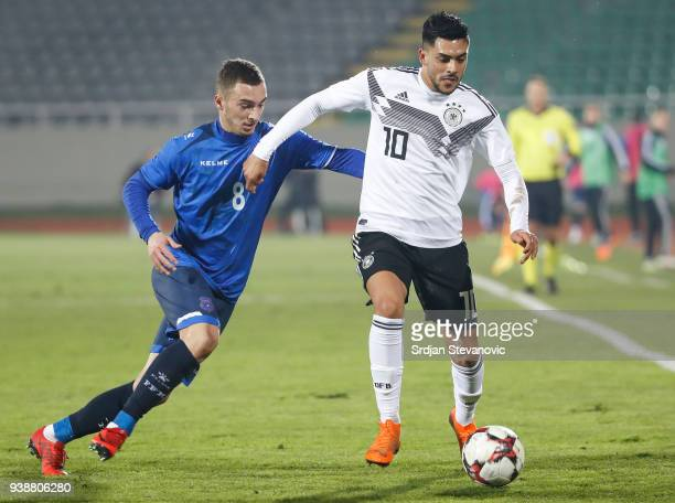 Nadiem Amiri of Germany in action against Florent Hasani of Kosovo during the 2019 UEFA Under21 European Championship qualifier match between Kosovo...