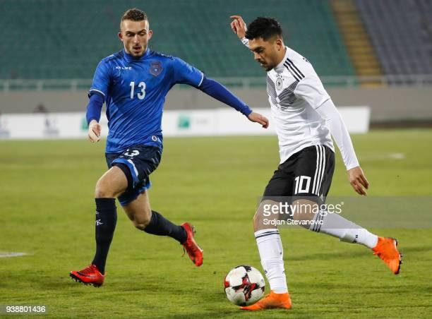 Nadiem Amiri of Germany in action against Lirim Mema of Kosovo during the 2019 UEFA Under21 European Championship qualifier match between Kosovo U21...