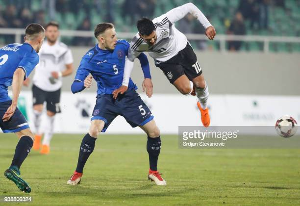 Nadiem Amiri of Germany is challenged by Ardian Ismajli of Kosovo during the 2019 UEFA Under21 European Championship qualifier match between Kosovo...