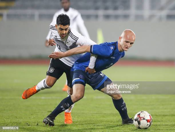 Nadiem Amiri of Germany is challenged by Arian Kabashi of Kosovo during the 2019 UEFA Under21 European Championship qualifier match between Kosovo...