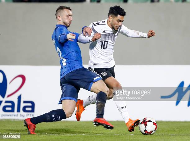 Nadiem Amiri of Germany is challenged by Lirim Mema of Kosovo during the 2019 UEFA Under21 European Championship qualifier match between Kosovo U21...