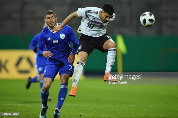 Nadiem Amiri of Germany is challenged by Yosef Raz Meir of Israel during the 2019 UEFA Under21 European Championship qualifier match between U21...