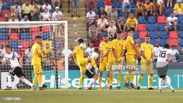 Nadiem Amiri of Germany scores his team's fourth goal during the 2019 UEFA U-21 Semi-Final match between Germany and Romania at Stadio Renato...