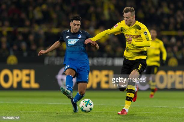 Nadiem Amiri of Hoffenheim and Andrey Yarmolenko of Dortmund battle for the ball during the Bundesliga match between Borussia Dortmund and TSG 1899...