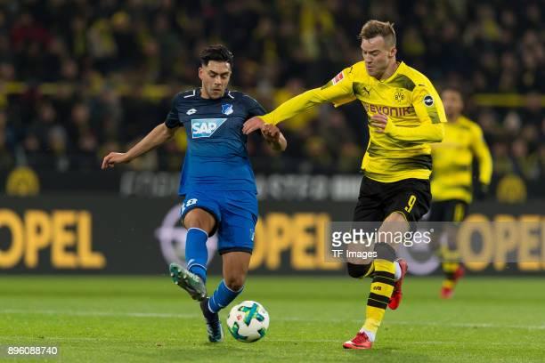 Nadiem Amiri of Hoffenheim and Andrey Yarmolenko of Dortmund battle for the ball during the Bundesliga match between Borussia Dortmund and TSG 1899...