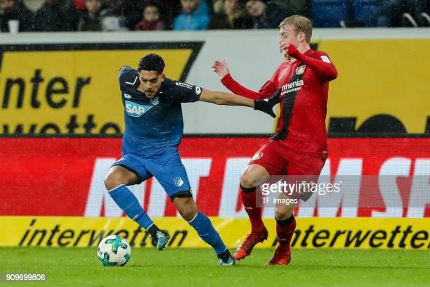 Nadiem Amiri of Hoffenheim and Julian Brandt of Leverkusen battle for the ball during the Bundesliga match between TSG 1899 Hoffenheim and Bayer 04...