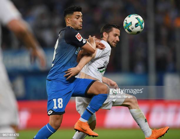 Nadiem Amiri of Hoffenheim and Julian Korb of Hannover compete for the ball during the Bundesliga match between TSG 1899 Hoffenheim and Hannover 96...