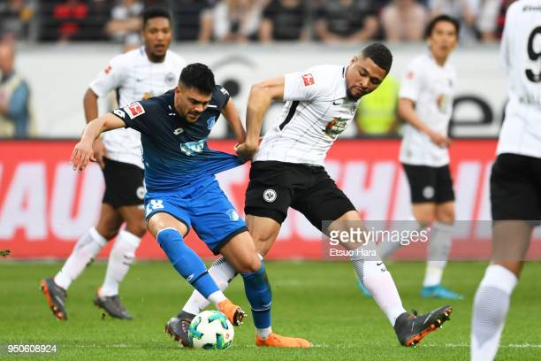 Nadiem Amiri of Hoffenheim and KevinPrince Boateng of Eintracht Frankfurt compete for the ball during the Bundesliga match between Eintracht...