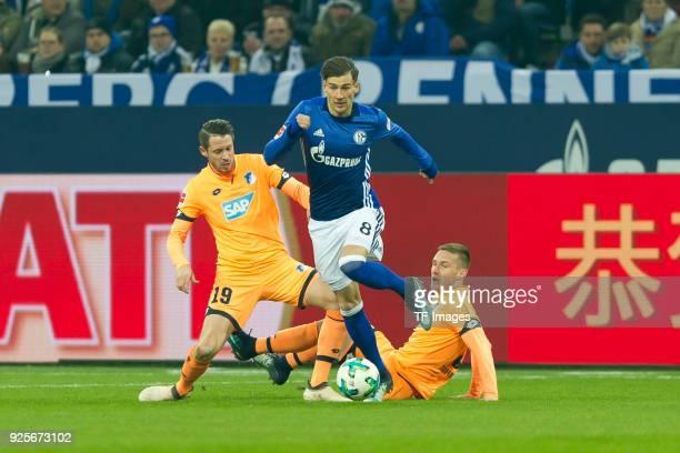 Nadiem Amiri of Hoffenheim and Leon Goretzka of Schalke battle for the ball during the Bundesliga match between FC Schalke 04 and TSG 1899 Hoffenheim...