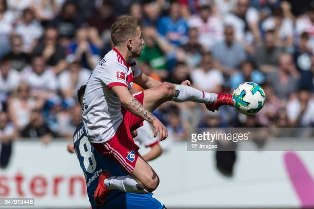 Nadiem Amiri of Hoffenheim and Lewis Holtby of Hamburg battle for the ball during the Bundesliga match between TSG 1899 Hoffenheim and Hamburger SV...