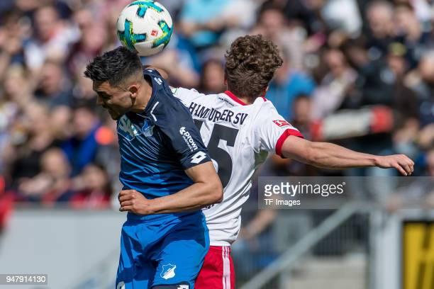 Nadiem Amiri of Hoffenheim and Luca Waldschmidt of Hamburg battle for the ball during the Bundesliga match between TSG 1899 Hoffenheim and Hamburger...