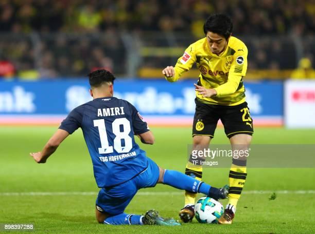 Nadiem Amiri of Hoffenheim and Shinji Kagawa of Dortmund battle for the ball during the Bundesliga match between Borussia Dortmund and TSG 1899...