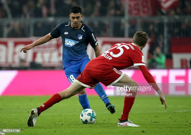 Nadiem Amiri of Hoffenheim and Thomas Mueller of Muenchen battle for the ball during the Bundesliga match between FC Bayern Muenchen and TSG 1899...