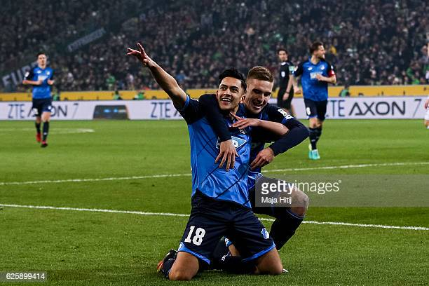 Nadiem Amiri of Hoffenheim celebrates with Pavel Kaderabek after scoring a goal to make it 11 during the Bundesliga match between Borussia...