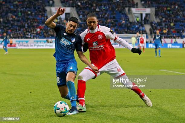 Nadiem Amiri of Hoffenheim fights for the ball with AbdouLakhad Diallo of Mainz during the Bundesliga match between TSG 1899 Hoffenheim and 1 FSV...
