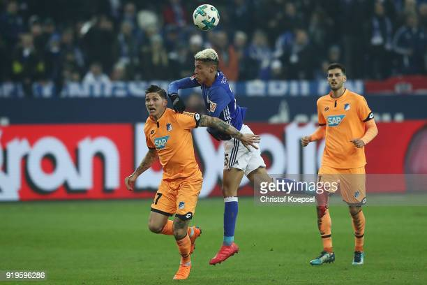 Nadiem Amiri of Hoffenheim fights for the ball with Amine Harit of Schalke during the Bundesliga match between FC Schalke 04 and TSG 1899 Hoffenheim...