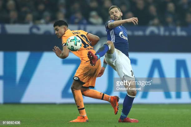 Nadiem Amiri of Hoffenheim fights for the ball with Guido Burgstaller of Schalke during the Bundesliga match between FC Schalke 04 and TSG 1899...