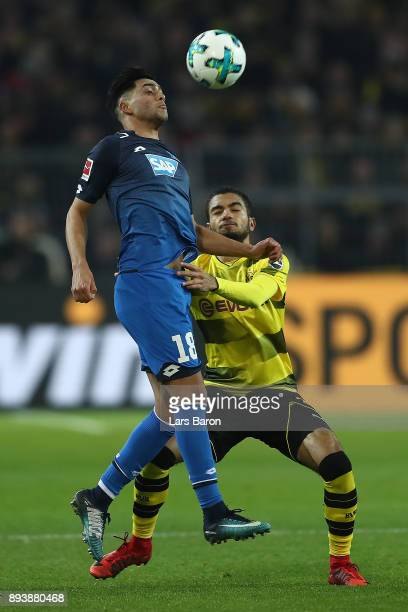 Nadiem Amiri of Hoffenheim fights for the ball with Jeremy Toljan of Dortmund during the Bundesliga match between Borussia Dortmund and TSG 1899...
