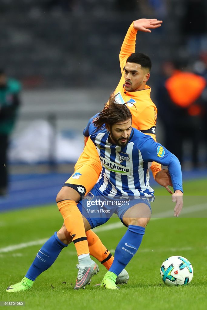 Nadiem Amiri of Hoffenheim (behind) fights for the ball with Marvin Plattenhardt of Berlin during the Bundesliga match between Hertha BSC and TSG 1899 Hoffenheim at Olympiastadion on February 3, 2018 in Berlin, Germany.