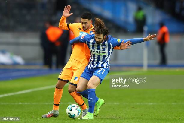 Nadiem Amiri of Hoffenheim fights for the ball with Marvin Plattenhardt of Berlin during the Bundesliga match between Hertha BSC and TSG 1899...
