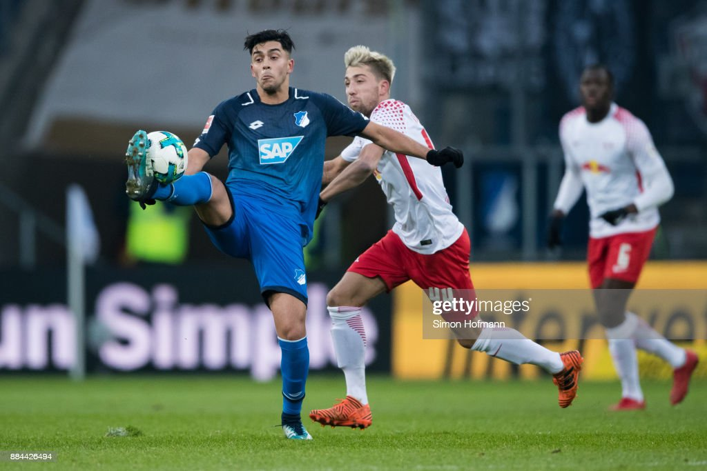 Nadiem Amiri of Hoffenheim is challenged by Kevin Kampl of Leipzig during the Bundesliga match between TSG 1899 Hoffenheim and RB Leipzig at Wirsol Rhein-Neckar-Arena on December 2, 2017 in Sinsheim, Germany.