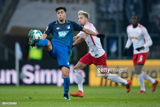 Nadiem Amiri of Hoffenheim is challenged by Kevin Kampl of Leipzig during the Bundesliga match between TSG 1899 Hoffenheim and RB Leipzig at Wirsol...