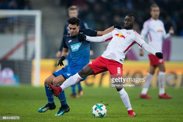 Nadiem Amiri of Hoffenheim is challenged by Naby Keita of Leipzig during the Bundesliga match between TSG 1899 Hoffenheim and RB Leipzig at Wirsol...