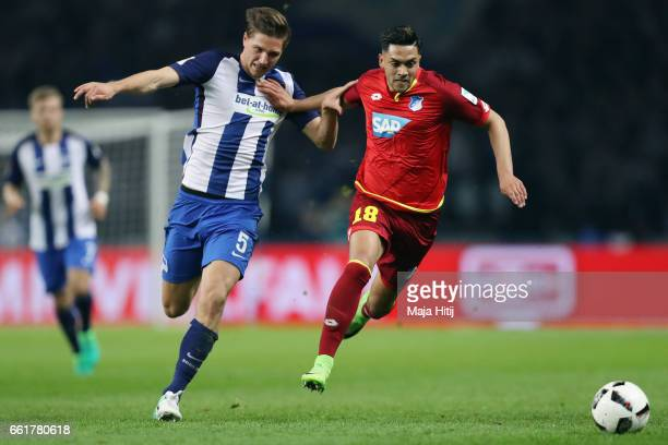 Nadiem Amiri of Hoffenheim is challenged by Niklas Stark of Berlin during the Bundesliga match between Hertha BSC and TSG 1899 Hoffenheim at...