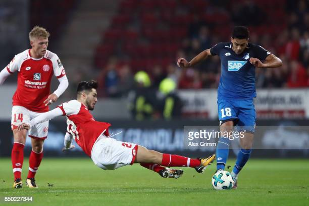 Nadiem Amiri of Hoffenheim is challenged by Suat Serdar of Mainz during the Bundesliga match between 1 FSV Mainz 05 and TSG 1899 Hoffenheim at Opel...