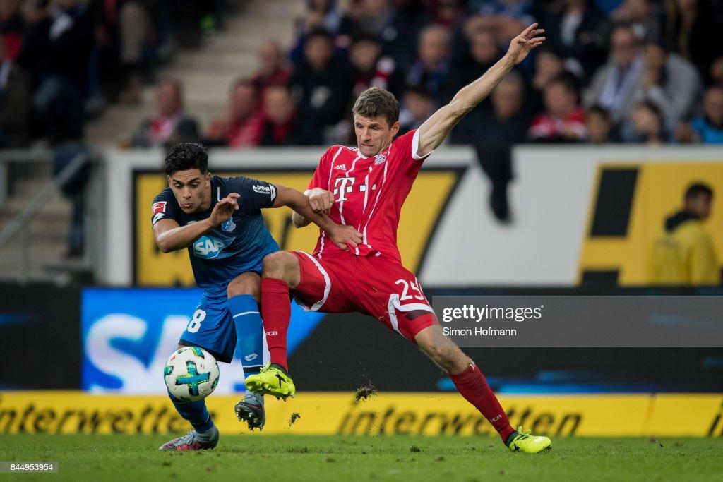 Nadiem Amiri of Hoffenheim is challenged by Thomas Mueller of Muenchen during the Bundesliga match between TSG 1899 Hoffenheim and FC Bayern Muenchen at Wirsol Rhein-Neckar-Arena on September 9, 2017 in Sinsheim, Germany.