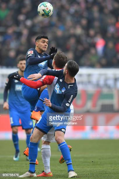 Nadiem Amiri of Hoffenheim jumps for a header during the Bundesliga match between FC Augsburg and TSG 1899 Hoffenheim at WWKArena on March 3 2018 in...