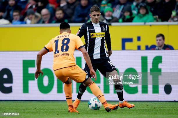 Nadiem Amiri of Hoffenheim Thorgan Hazard of Borussia Monchengladbach during the German Bundesliga match between Borussia Monchengladbach v 1899...