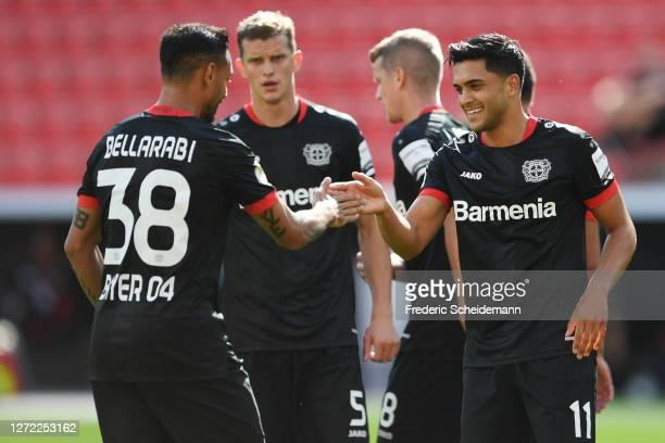 Nadiem Amiri of Leverkusen celebrates his team's second goal with teammate Karim Bellarabi during the DFB Cup first round match between Eintracht...
