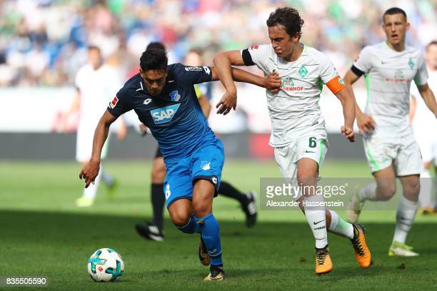 Nadiem Amiri of TSG 1899 Hoffenheim and Thomas Delaney of Werder Bremen during the Bundesliga match between TSG 1899 Hoffenheim and SV Werder Bremen...