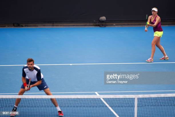 Nadiia Kichenok of Ukraine and Marcel Granollers of Spain talk tactics in their first round mixed doubles match against Olga Savchuk of Ukraine and...
