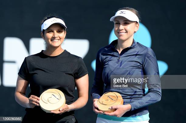 Nadiia Kichenok of Ukraine and Sania Mirza of India celebrate after winning their final doubles match against Zhang Shuai and Shuai Peng of Chinaon...