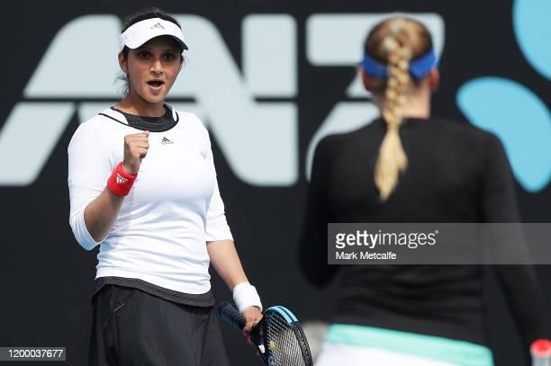 Nadiia Kichenok of Ukraine and Sania Mirza of India celebrate winning match point during their semi final doubles match against Maria Bouzkova of...